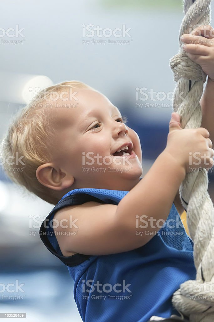 toddler exercising on play equipment royalty-free stock photo