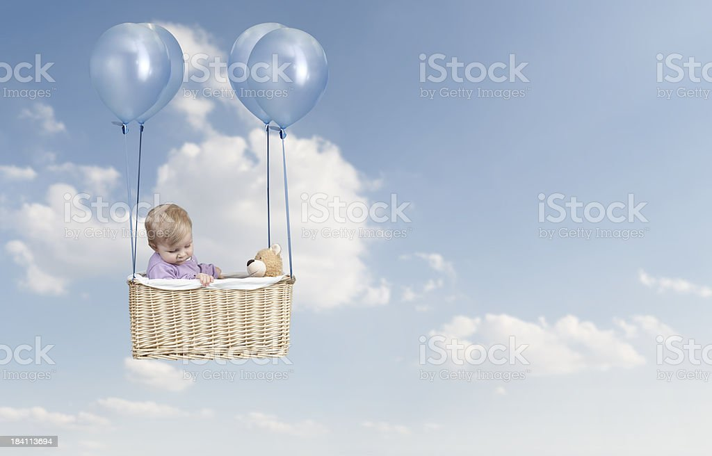Toddler flying in a hot air balloon stock photo