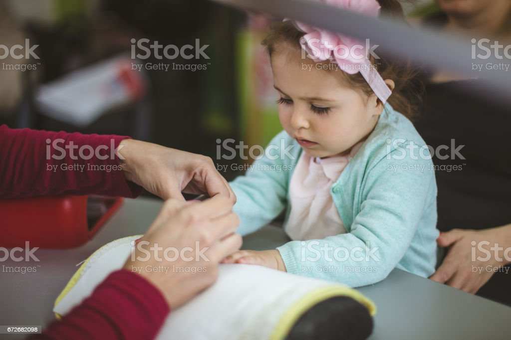 Toddler girl gets her nails done stock photo
