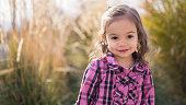 Toddler Girl in Hay Field