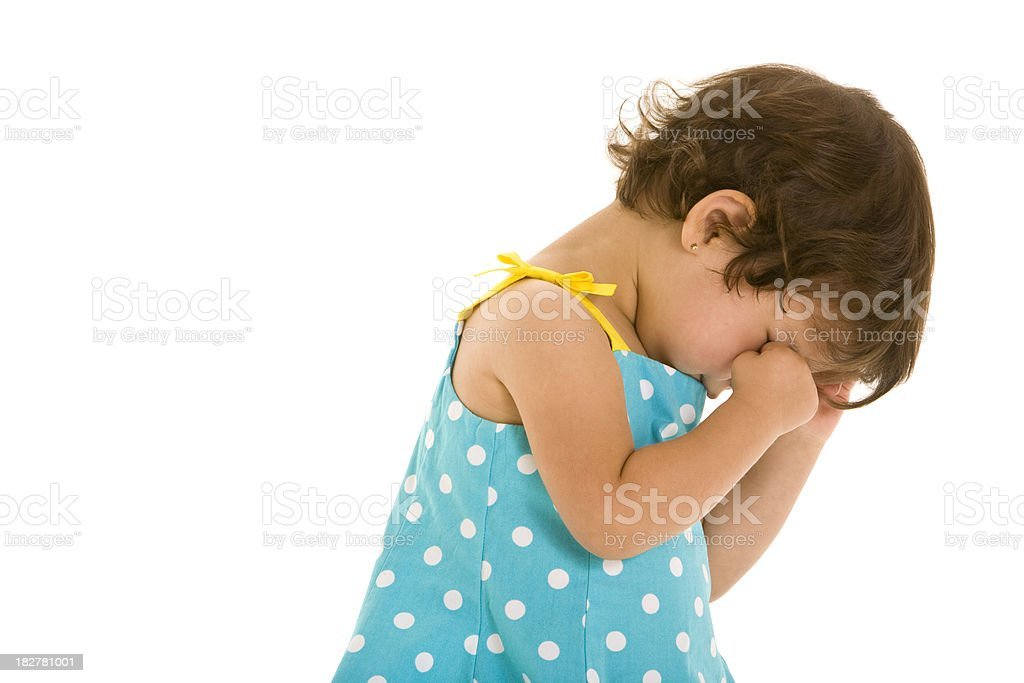 Toddler girl looking away and rubbing her eyes royalty-free stock photo