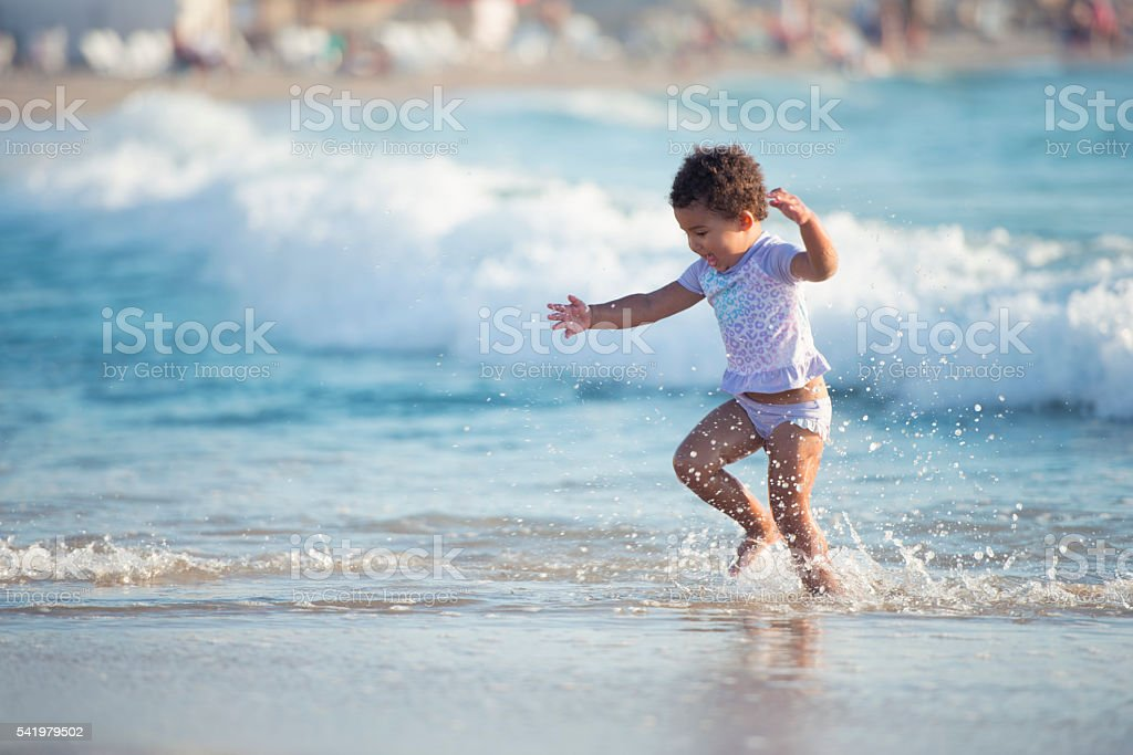 Toddler girl on sea beach vacation. stock photo