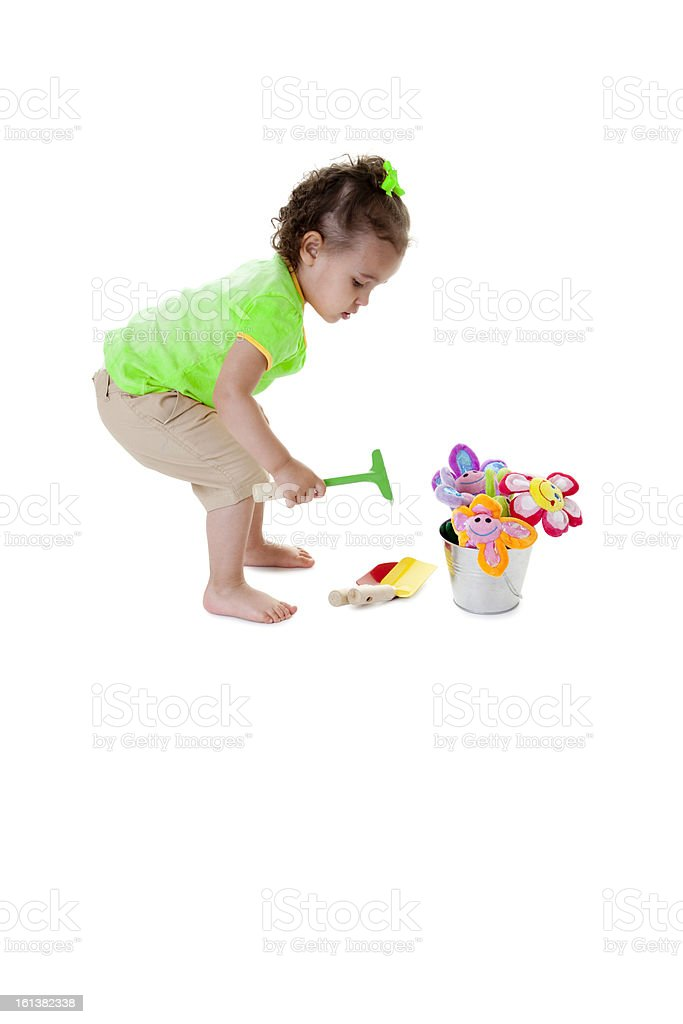 Toddler Girl Planting Flowers royalty-free stock photo