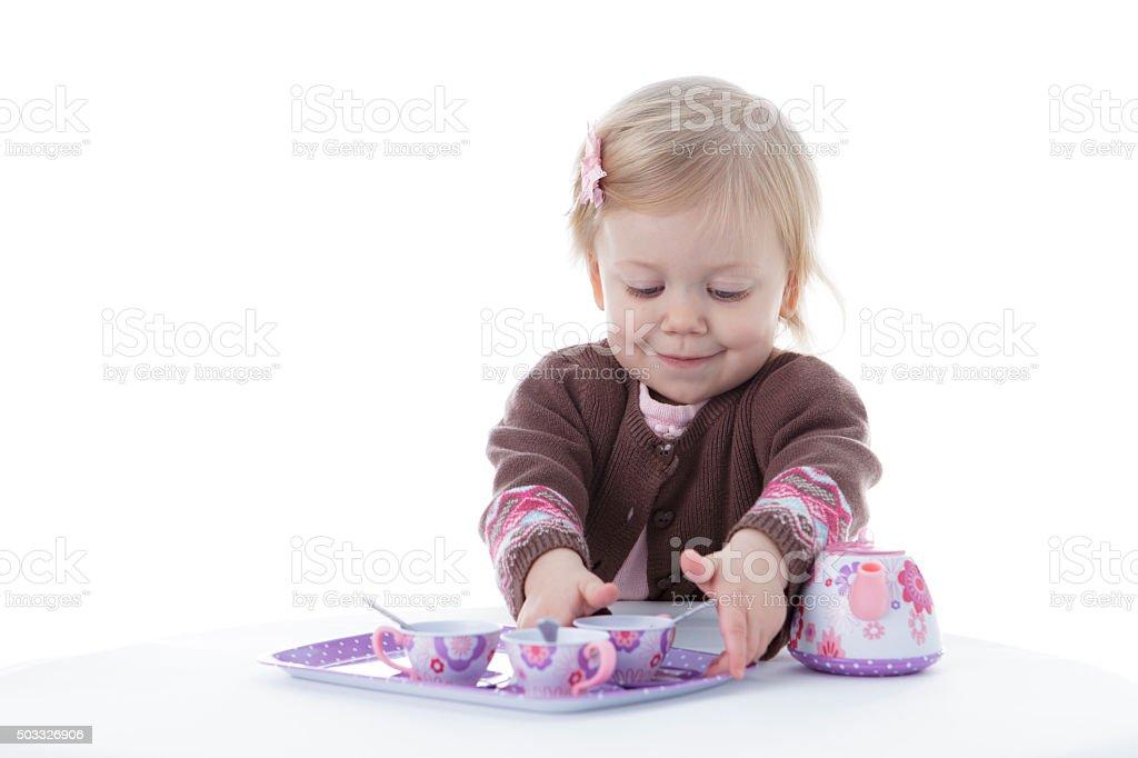 toddler girl playing stock photo
