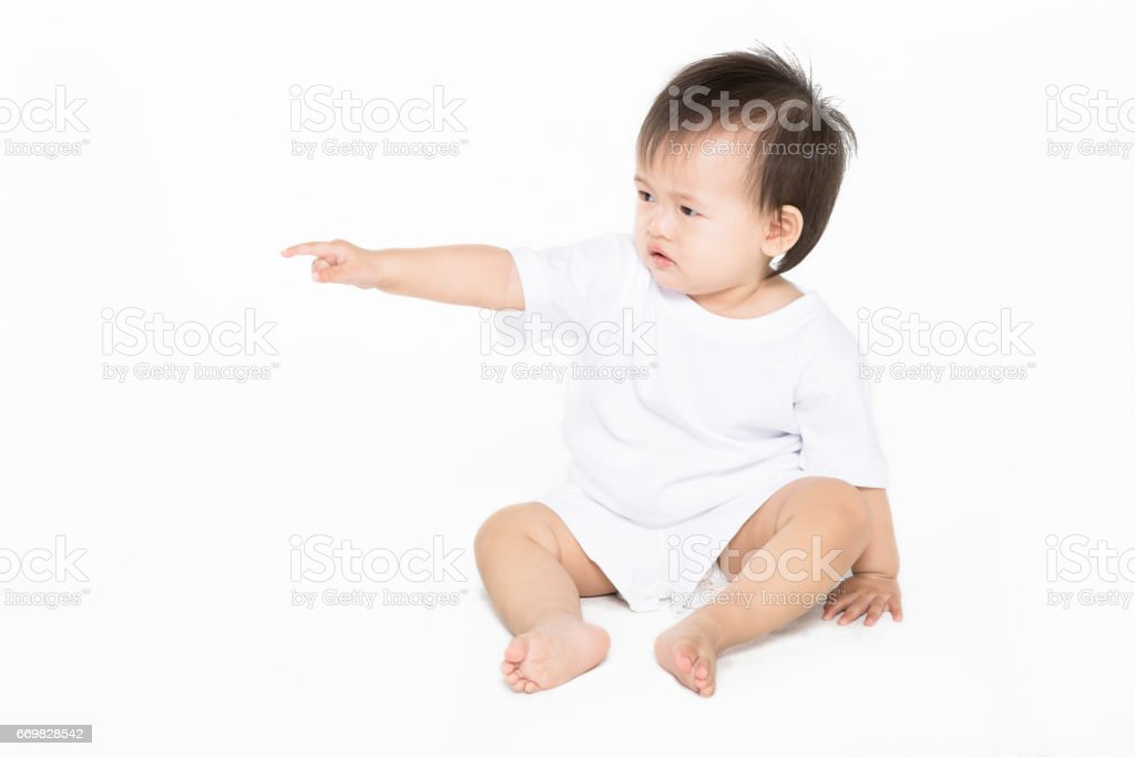 toddler girl sitting on the ground stock photo
