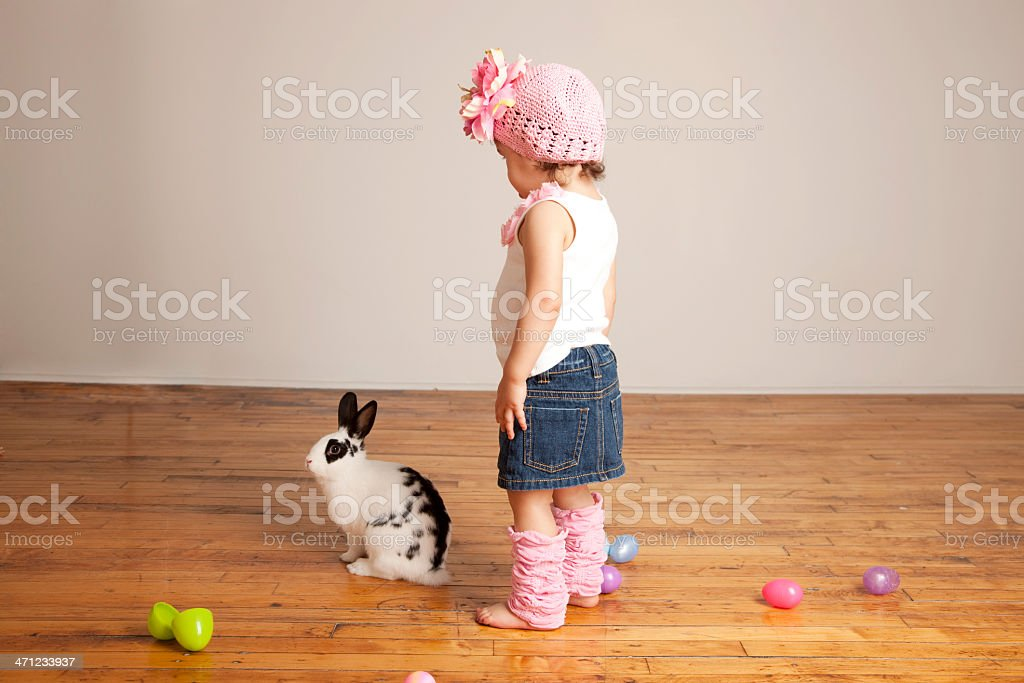 Toddler Girl with Easter Eggs and Bunny Rabbit royalty-free stock photo