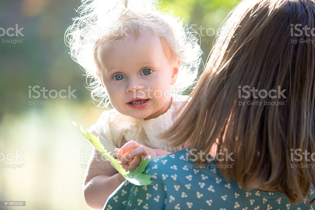Toddler girl with her mom stock photo