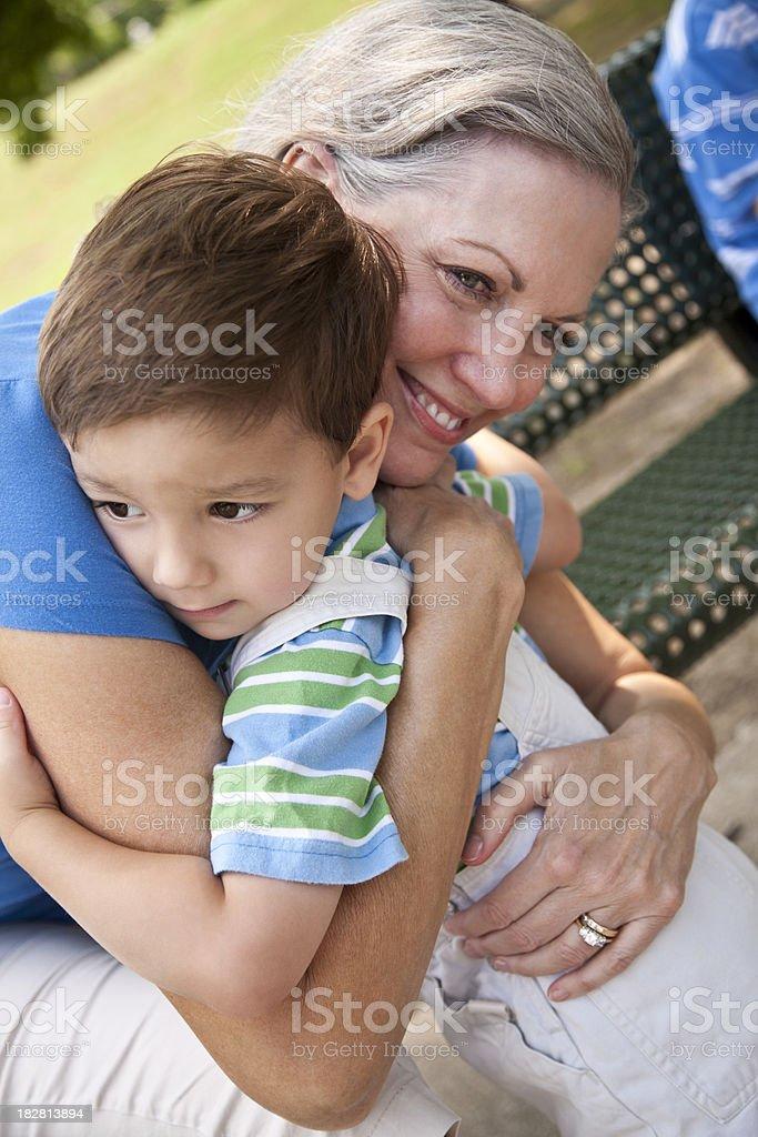 Toddler Giving His Grandmother a Big Hug royalty-free stock photo