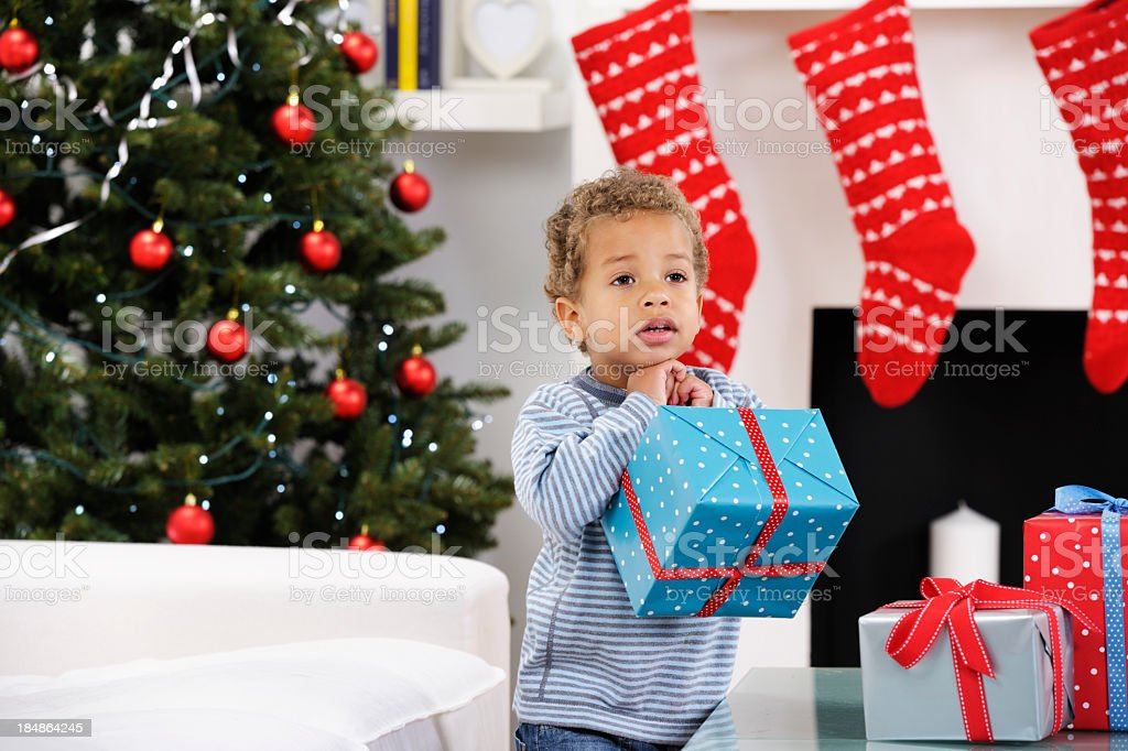 Toddler Holding A Christmas Present royalty-free stock photo