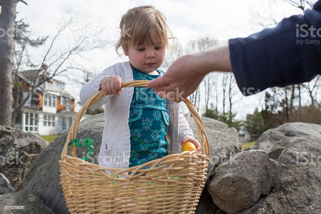 Toddler hunting for Easter eggs on Easter Sunday.