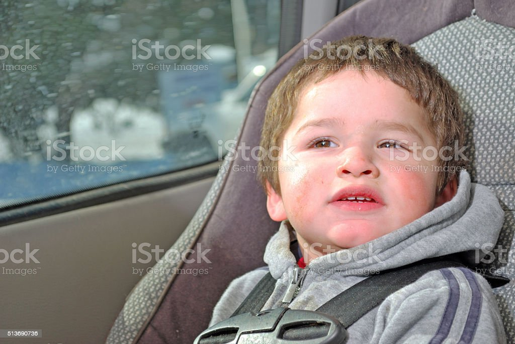 Toddler in a Carseat stock photo