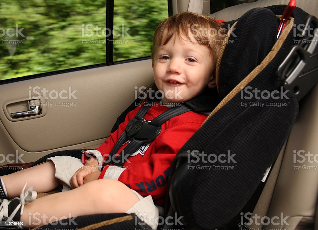 Toddler in Carseat stock photo