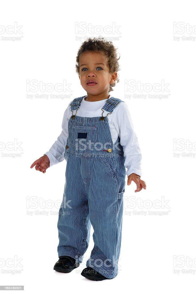 Toddler In Classic Striped Dungarees stock photo