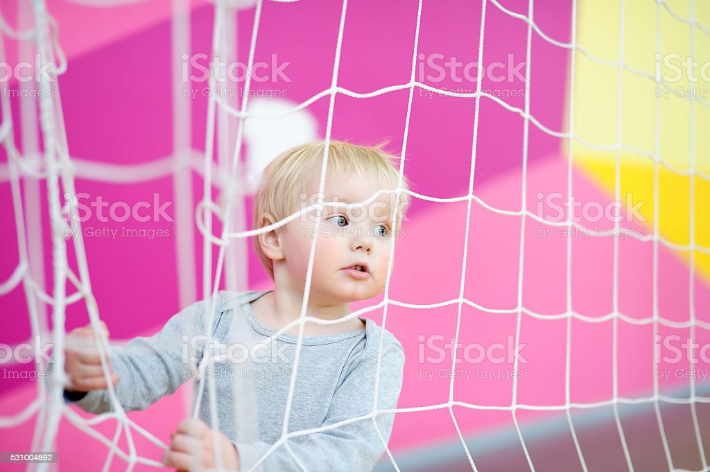 Toddler in indoors sport court stock photo
