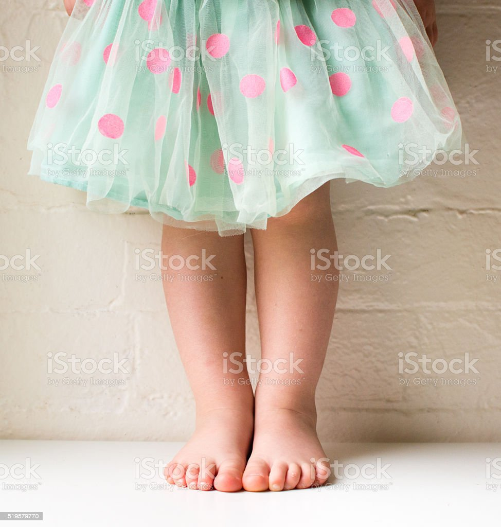 Toddler in polka dot skirt stock photo