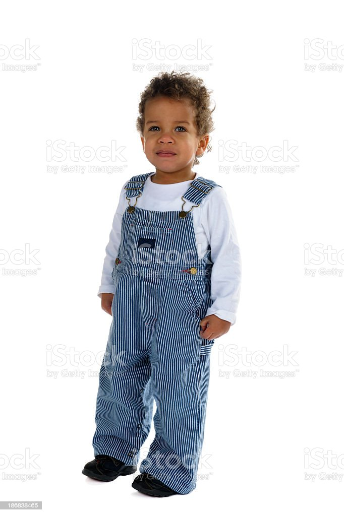 Toddler In Striped Classic Dungarees Standing And Smiling royalty-free stock photo
