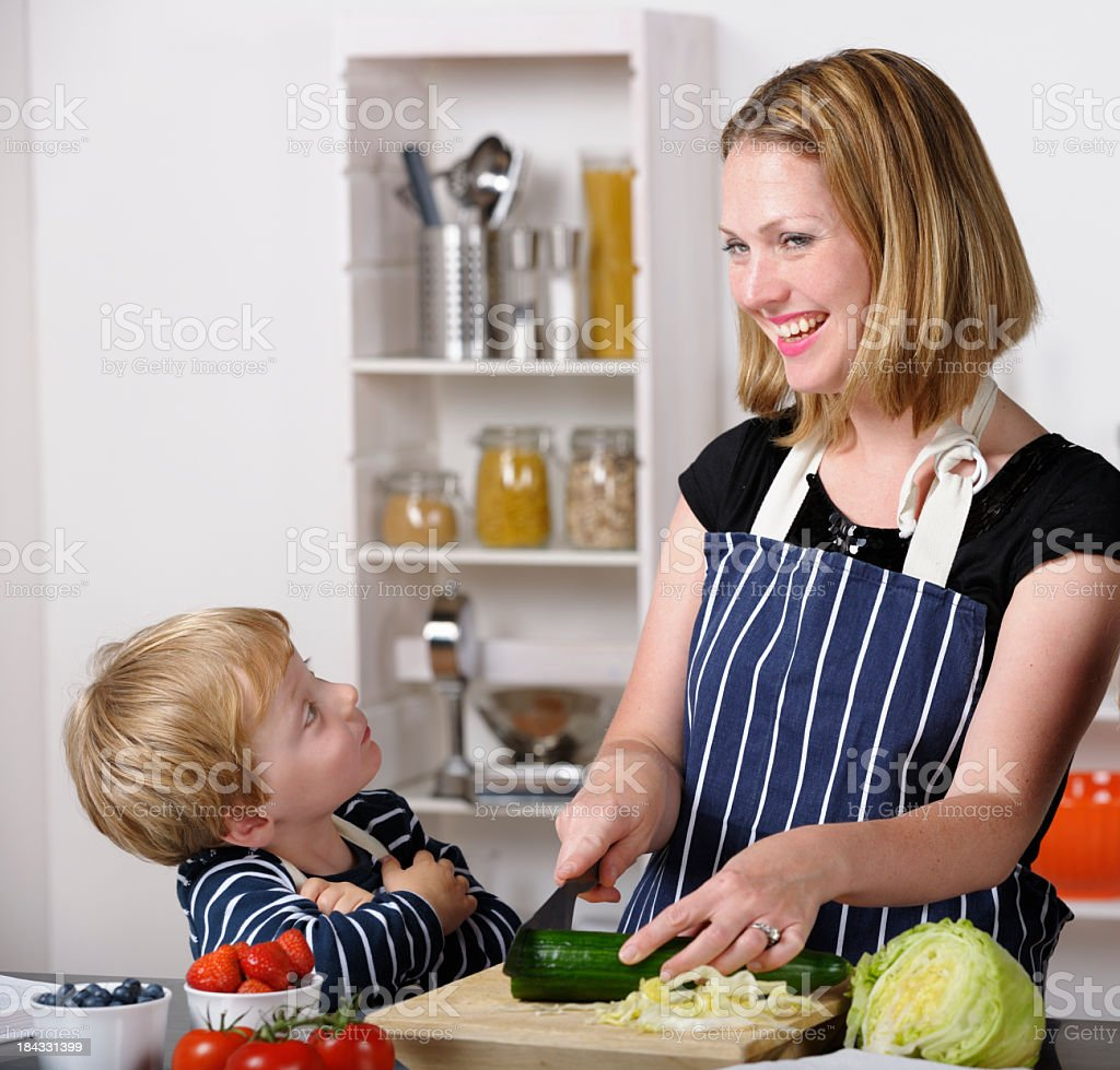 Toddler Interacting With His Mother While She Preapres Meal royalty-free stock photo