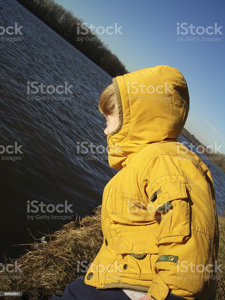 Toddler Leaning Toward Grand River Water in Michigan: Danger royalty-free stock photo