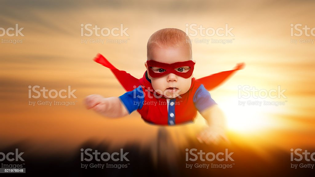 toddler little baby superman superhero with red cape flying stock photo