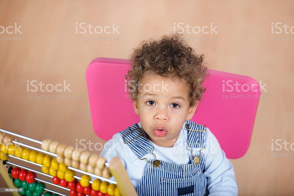 Toddler Looking Upwards During Playtime stock photo