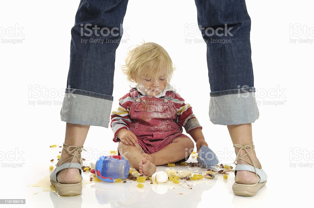 Toddler making a mess on the floor royalty-free stock photo