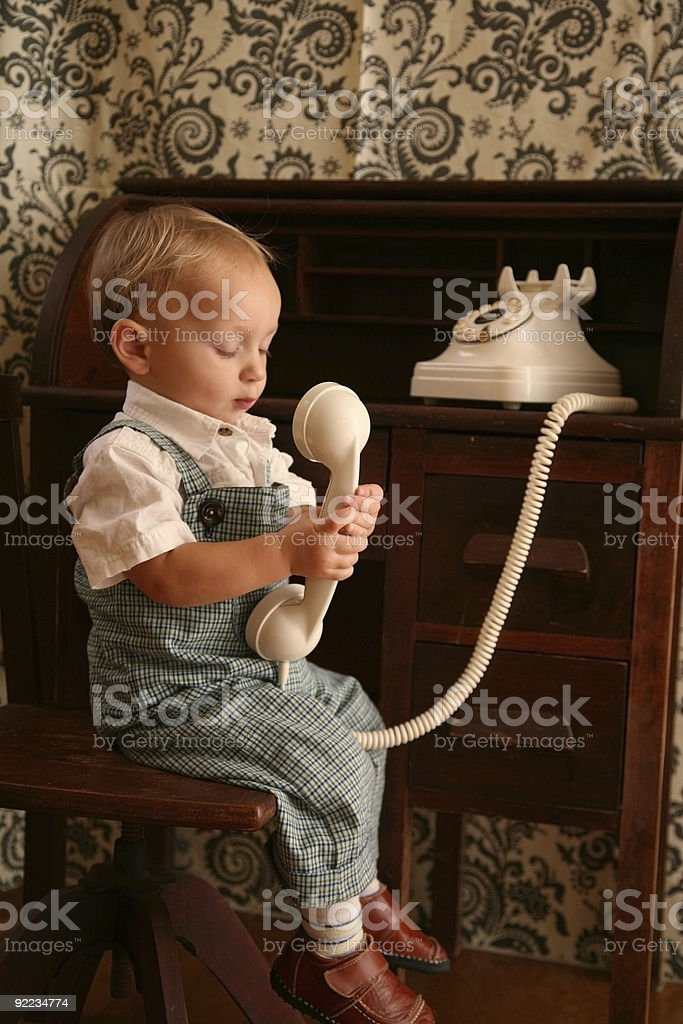 Toddler on Antique Phone2 royalty-free stock photo