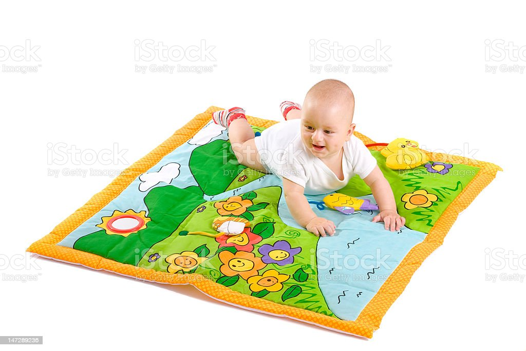 Toddler on playmat stock photo