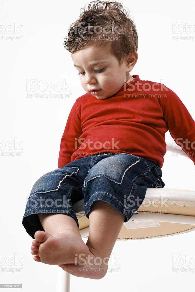 Toddler on stool.  Along way down royalty-free stock photo