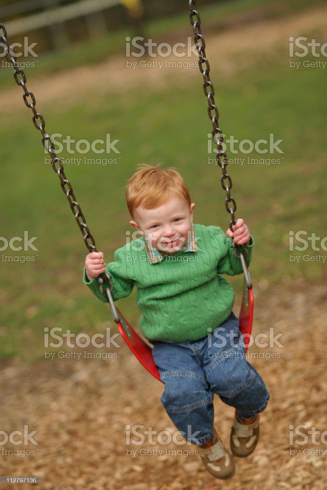 Toddler on swing - 1 royalty-free stock photo