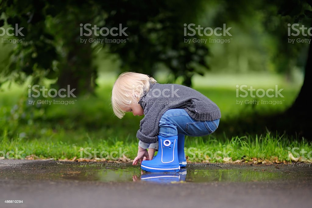 Toddler playing at the summer or autumn day stock photo