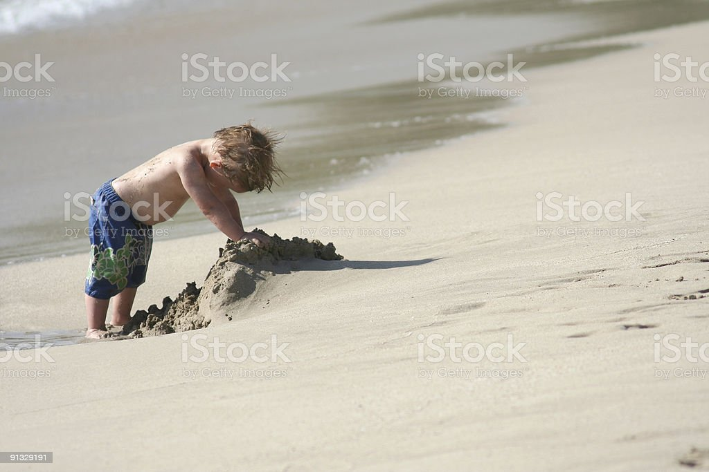 Toddler playing on the beach royalty-free stock photo