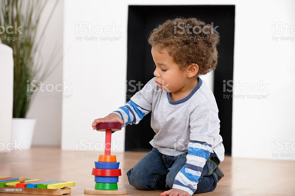 Toddler Playing With Rings In The Living Room stock photo