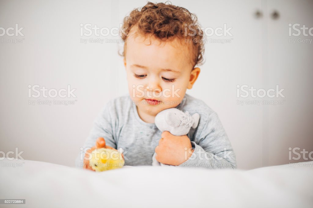 Toddler playing with toy stock photo