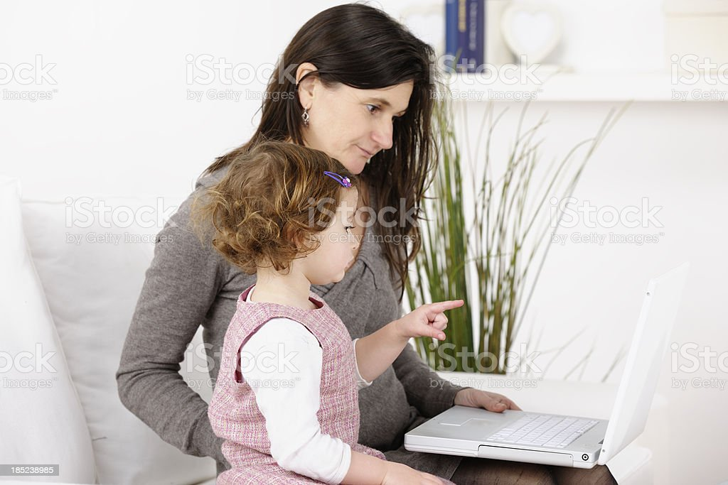 Toddler Pointing Something Out On The Laptop stock photo