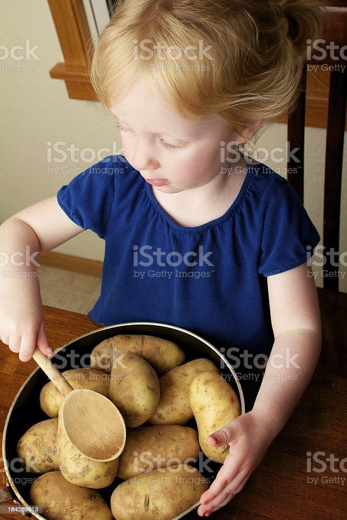 Toddler pretending to cook stock photo