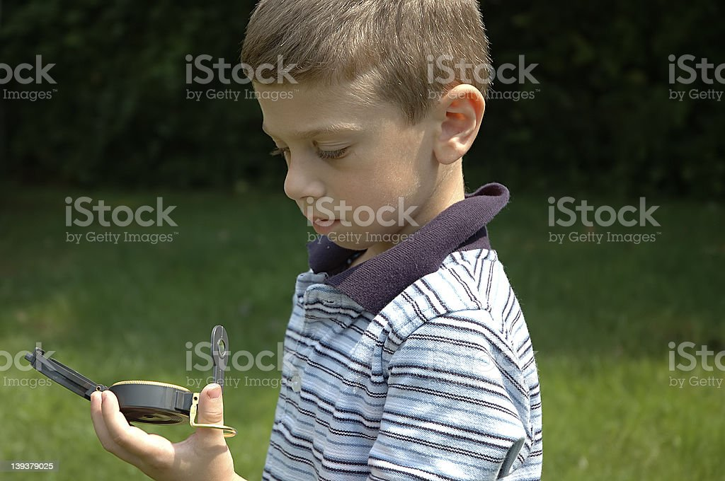 Toddler Reading Compass royalty-free stock photo