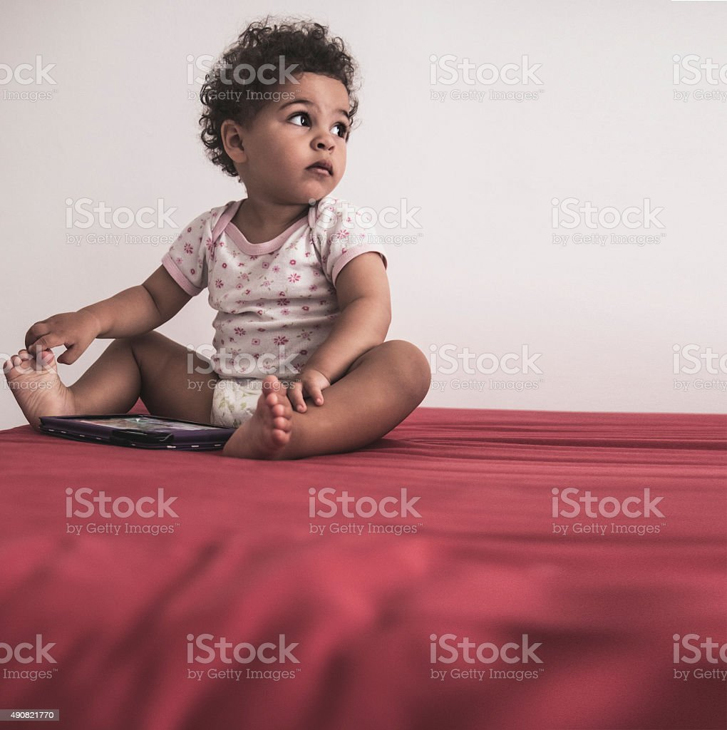 Toddler (2-3) Using Digital Tablet at Home stock photo