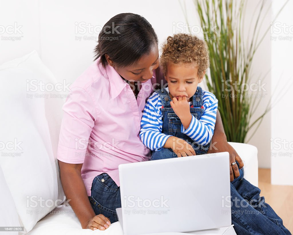 Toddler Using Laptop/ Computer With Mother/  Carer royalty-free stock photo