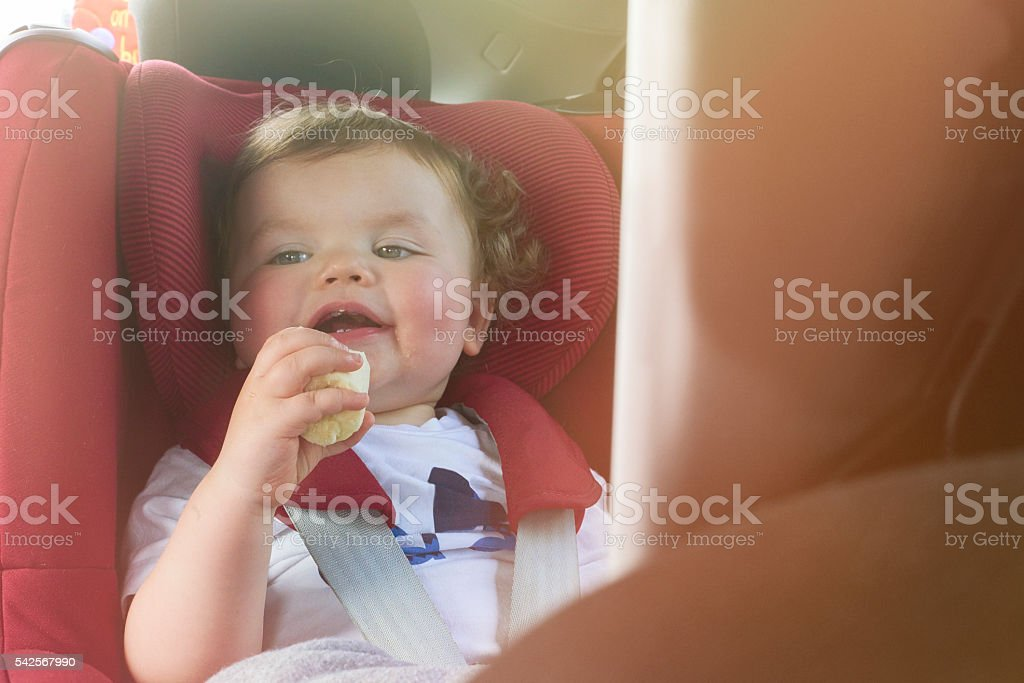 Toddler watching a film in the car stock photo