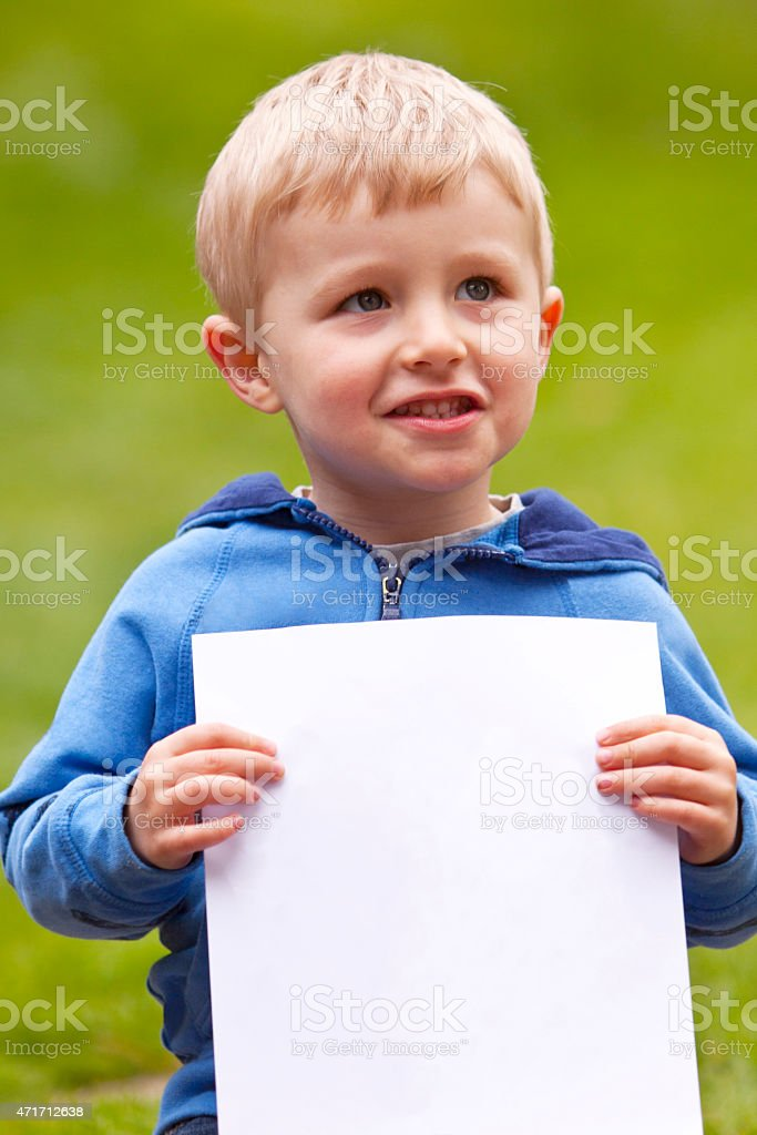 Toddler with Blank Paper stock photo