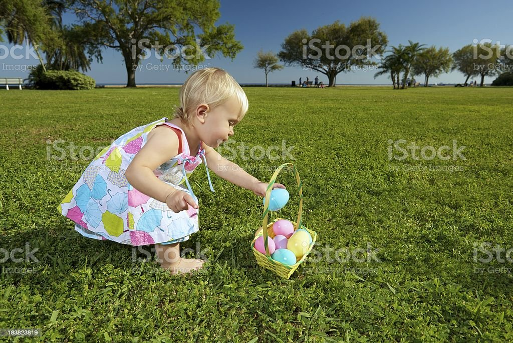 Toddler with Easter Eggs stock photo