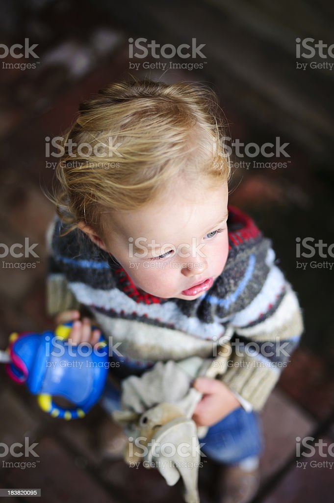 Toddler with favourite toy ready for adventure stock photo