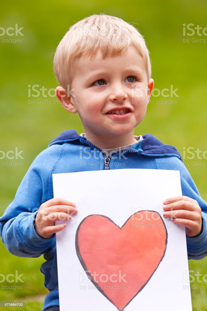 Toddler with Heart Drawing stock photo