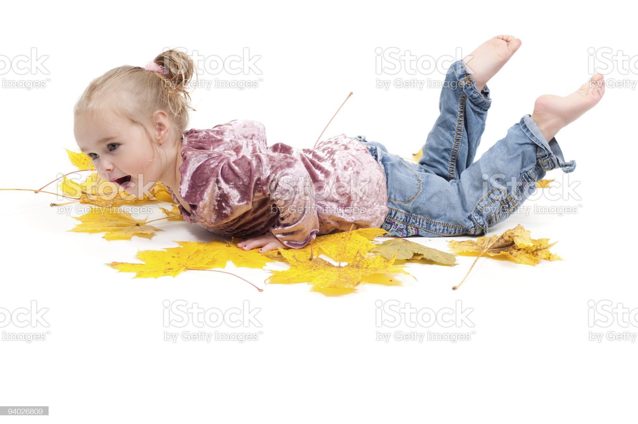 Toddler with maple leaves royalty-free stock photo
