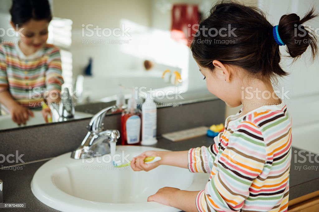 Toddler with toobrush stock photo