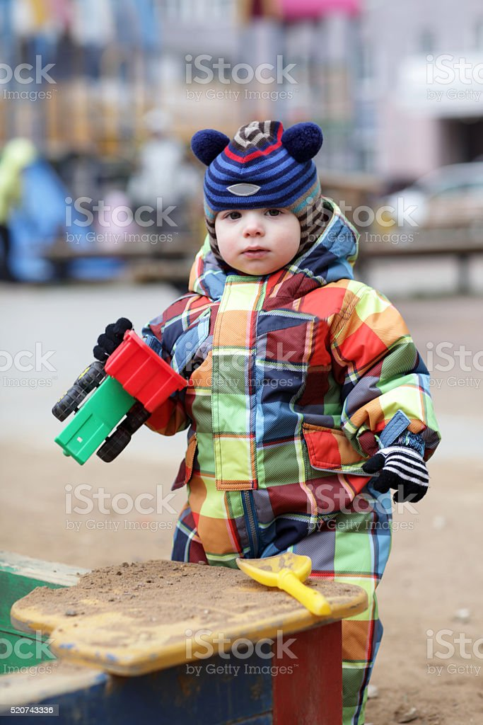 Toddler with toy car stock photo