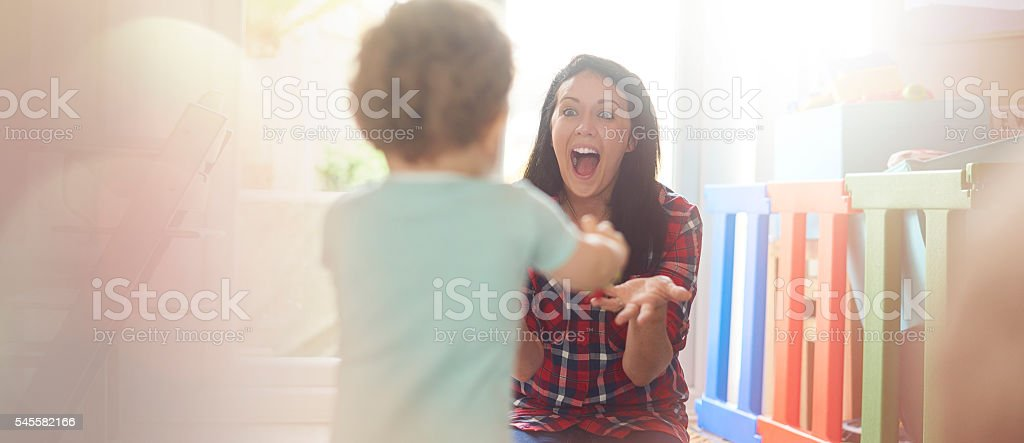 Toddler's first steps stock photo
