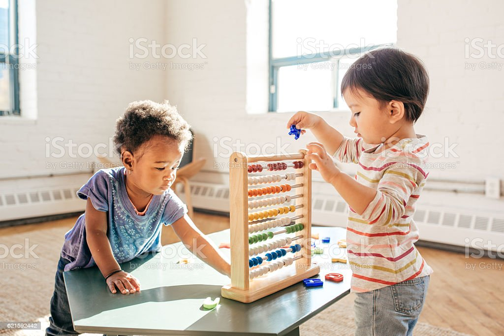 Toddlers in kindergarten stock photo