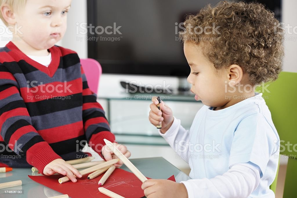 Toddlers Interacting While Doing Artwork In the Living Room royalty-free stock photo