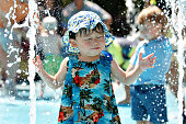 Toddlers playing in water park